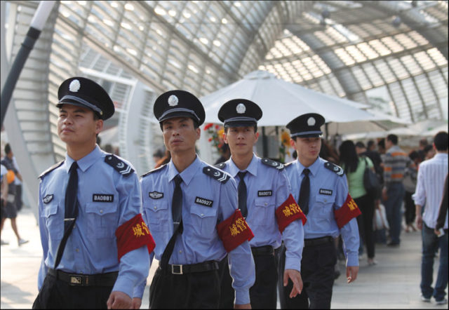 A group of chengguan urban law enforcers in Shenzhen. Photo: Wilson L.