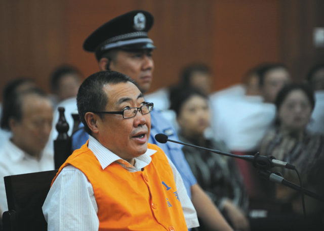 'Watch Brother' Yang Dacai, former head of the work safety administration of Shaanxi province, speaks during his trial on charges of corruption at the Xi'an Intermediate People's Court, Shaanxi province, 30 August 2013. Source: ImagineChina
