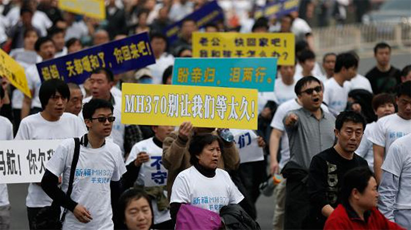 On 25 March 2014, family members of passengers on board flight MH370 marched on the Malaysian Embassy in Beijing demanding answers from the authorities Source: Zhang Lintao