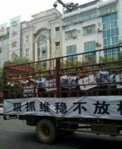 In October 2014, fifteen suspects were driven through the streets of Yueyang, Hunan province, on the back of a truck labelled the 'Prisoner Van', before being taken to a public trial that was watched by thousands Photo: Weibo