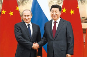 Relations between China and Russia strengthen: Presidents Putin and Xi, shown here at the 2014 APEC Summit held in Beijing. Their growing personal relationship emulates their countries' converging interests in trade, investment and geopolitics Source: People's Daily Online