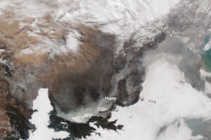 November 2015: As world leaders converged on Paris for the World Climate Change Conference 2015, residents of Beijing and other cities in eastern China faced the most severe air pollution the nation saw that year Photo: earthobservatory.nasa.gov