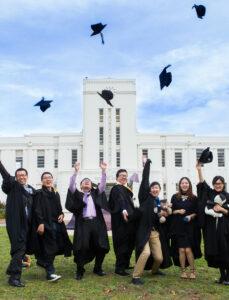 ANU graduates in front of the ANU School of Art and Design.